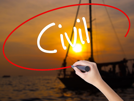 Woman Hand Writing Civil with a marker over transparent board. Isolated on Sunset Boat. Business concept. Stock Photo Stock Photo