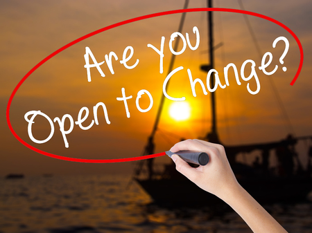 displacement: Woman Hand Writing Are you Open to Change? with a marker over transparent board. Isolated on Sunset Boat. Business concept. Stock Photo Stock Photo