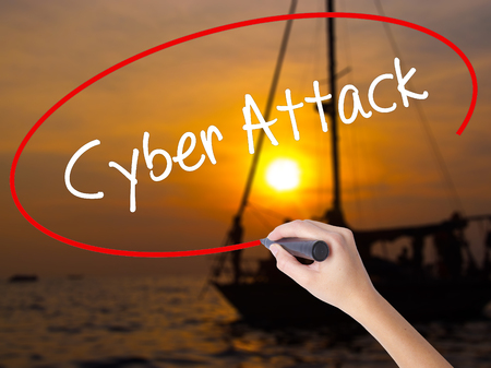 Woman Hand Writing Cyber Attack with a marker over transparent board. Isolated on Sunset Boat. Business concept. Stock Photo Stock Photo