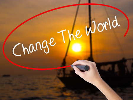 fraternidad: Woman Hand Writing Change The World with a marker over transparent board. Isolated on Sunset Boat. Business concept. Stock Photo Foto de archivo