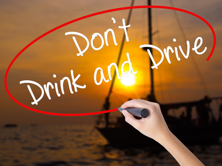 drunk test: Woman Hand Writing Dont Drink and Drive with a marker over transparent board. Isolated on Sunset Boat. Life, technology, internet concept. Stock Image