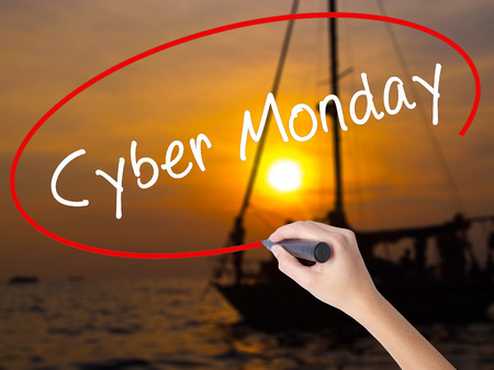 Woman Hand Writing Cyber Monday with a marker over transparent board. Isolated on Sunset Boat. Business, technology, internet concept. Stock Image Stock Photo