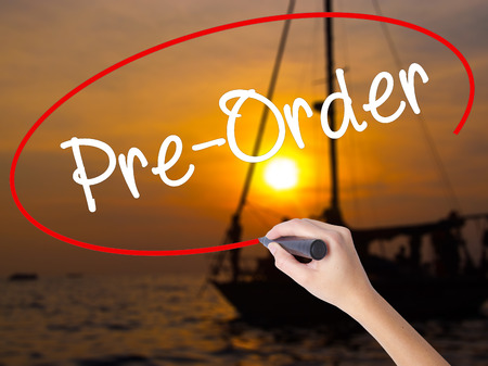 preorder: Woman Hand Writing Pre-Order  with a marker over transparent board. Isolated on Sunset Boat. Business concept. Stock Photo Stock Photo