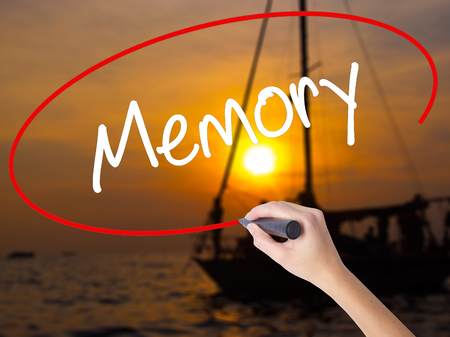 narrator: Woman Hand Writing Memory  with a marker over transparent board. Isolated on Sunset Boat. Business concept. Stock Photo Stock Photo