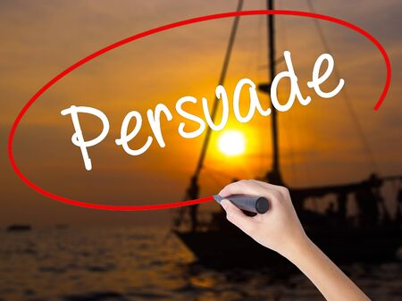 persuade: Woman Hand Writing Persuade with a marker over transparent board. Isolated on Sunset Boat. Business concept. Stock Photo