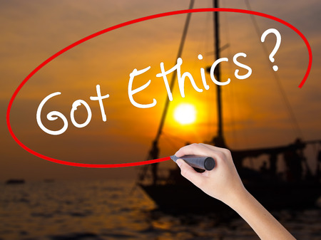 Woman Hand Writing Got Ethics with a marker over transparent board. Isolated on Sunset Boat. Business, technology, internet concept. Stock Image
