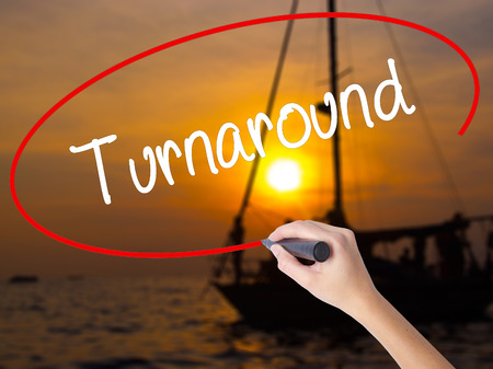 sustained: Woman Hand Writing Turnaround with a marker over transparent board. Isolated on Sunset Boat. Business concept. Stock Photo