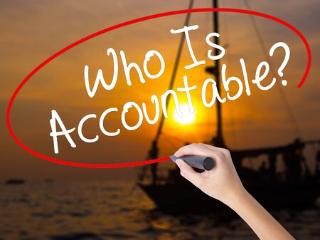 accountable: Woman Hand Writing Who Is Accountable? with a marker over transparent board. Isolated on Sunset Boat. Business, technology, internet concept. Stock Image
