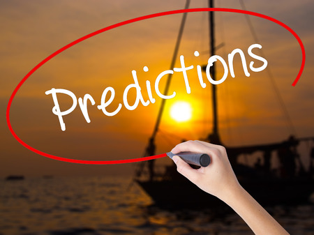 predictions: Woman Hand Writing Predictions  with a marker over transparent board. Isolated on Sunset Boat. Business concept. Stock Photo