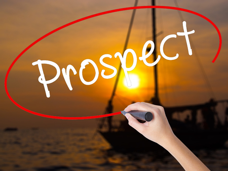 prospector: Woman Hand Writing Prospect with a marker over transparent board. Isolated on Sunset Boat. Business, technology, internet concept. Stock Image
