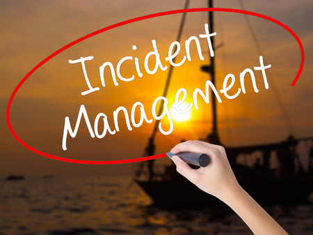 iscp: Woman Hand Writing Incident Management with a marker over transparent board. Isolated on Sunset Boat. Business concept. Stock Photo