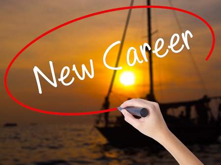 joblessness: Woman Hand Writing New Career with a marker over transparent board. Isolated on Sunset Boat. Business concept. Stock Photo