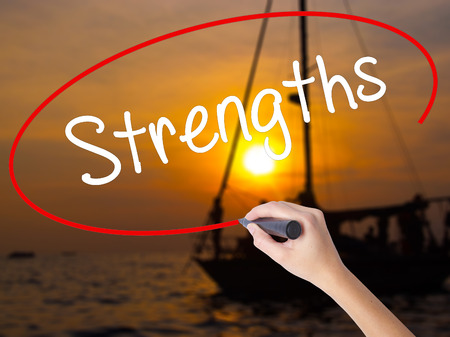 appraise: Woman Hand Writing Strengths with a marker over transparent board. Isolated on Sunset Boat. Business concept. Stock Photo Stock Photo