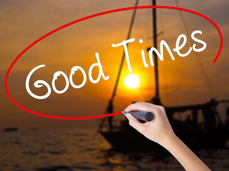 good times: Woman Hand Writing Good Times with a marker over transparent board. Isolated on Sunset Boat. Business concept. Stock Photo Stock Photo