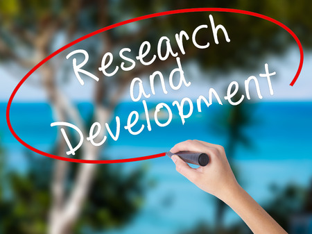 Woman Hand Writing Research and Development with black marker on visual screen. Isolated on nature. Business concept. Stock Photo Stock Photo