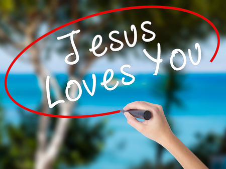 testament schreiben: Woman Hand Writing Jesus Loves You with black marker on visual screen. Isolated on nature. Religion, technology, internet concept. Stock Image Lizenzfreie Bilder