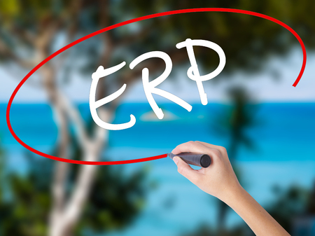Woman Hand Writing  ERP (Enterprise Resource Planning)   with black marker on visual screen. Isolated on nature. Business concept. Stock Photo Stock Photo