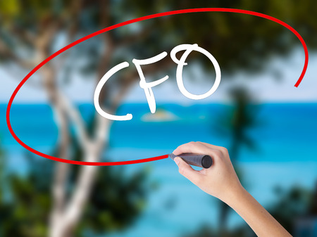 comité d entreprise: Woman Hand Writing CFO (Chief Financial Officer) with black marker on visual screen. Isolated on nature. Business concept. Stock Photo