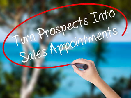 immediate: Woman Hand Writing Turn Prospects Into Sales Appointments  with black marker on visual screen. Isolated on nature. Business concept. Stock Photo Stock Photo