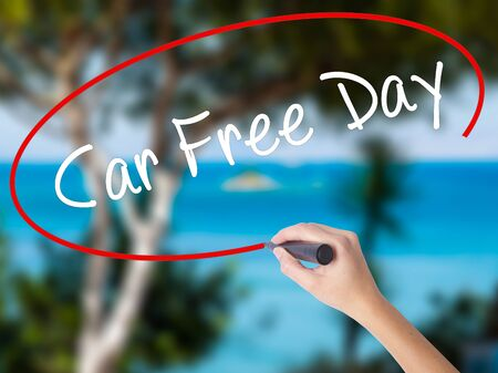 Woman Hand Writing Car Free Day with black marker on visual screen. Isolated on nature. Business concept. Stock Photo