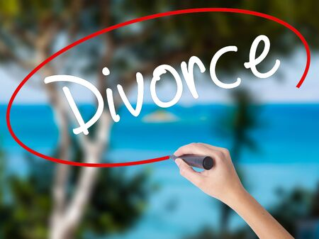 ex wife: Woman Hand Writing Divorce  with black marker on visual screen. Isolated on nature. Business concept. Stock Photo