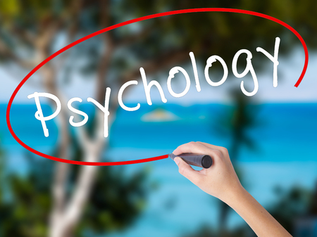 psychoanalysis: Woman Hand Writing Psychology with black marker on visual screen. Isolated on nature. Business concept. Stock Photo