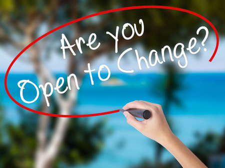 Woman Hand Writing Are you Open to Change? with black marker on visual screen. Isolated on nature. Business concept. Stock Photo