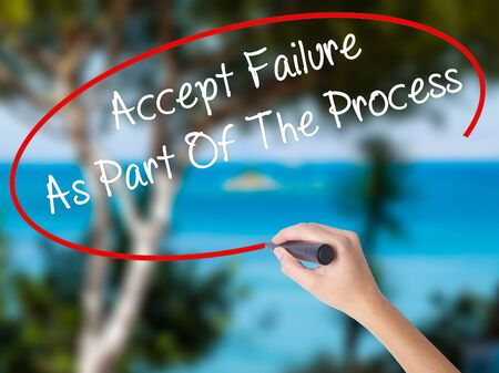 Woman Hand Writing Accept Failure As Part Of The Process with black marker on visual screen. Isolated on nature. Business concept. Stock Photo Stock Photo