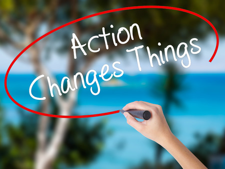 Woman Hand Writing Action Changes Things with black marker on visual screen. Isolated on nature. Business concept. Stock Photo