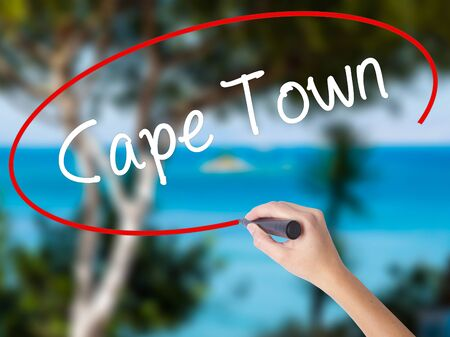 Woman Hand Writing Cape Town with black marker on visual screen. Isolated on nature. Business concept. Stock Photo Stock Photo