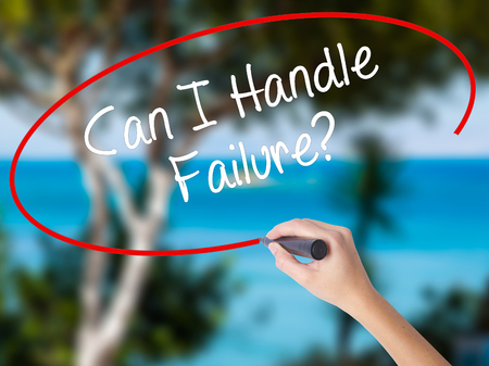 Woman Hand Writing Can I Handle Failure? with black marker on visual screen. Isolated on nature. Business concept. Stock Photo Stock Photo