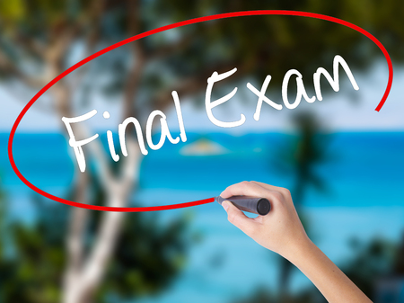 Woman Hand Writing Final Exam with black marker on visual screen Isolated on nature Business concept Stock Photo