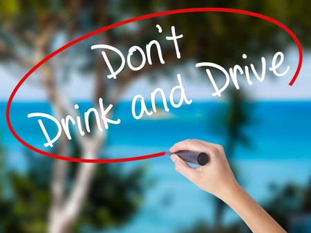 Woman Hand Writing Dont Drink and Drive with black marker on visual screen. Isolated on nature. Life, technology, internet concept. Stock Image