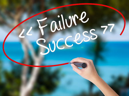 Woman Hand Writing Failure Success with black marker on visual screen. Isolated on nature. Business concept. Stock Photo