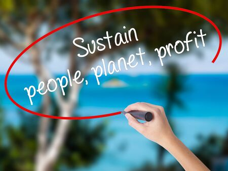 Woman Hand Writing Sustain, people, planet, profit with black marker on visual screen. Isolated on nature. Business concept. Stock Photo