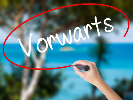 next horizon: Woman Hand Writing Vorwarts  (Forward In German)  with black marker on visual screen. Isolated on nature. Business concept. Stock Photo Stock Photo