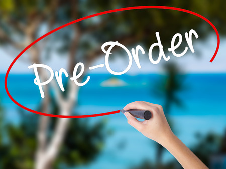preorder: Woman Hand Writing Pre-Order  with black marker on visual screen. Isolated on nature. Business concept. Stock Photo Stock Photo