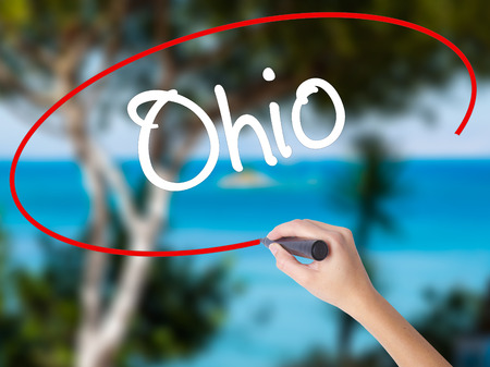 Woman Hand Writing Ohio  with black marker on visual screen. Isolated on nature. Business concept. Stock Photo Stock Photo