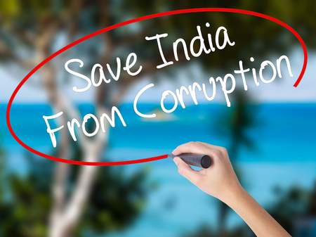Woman Hand Writing Save India From Corruption with black marker on visual screen. Isolated on nature. Business concept. Stock Photo Stock Photo