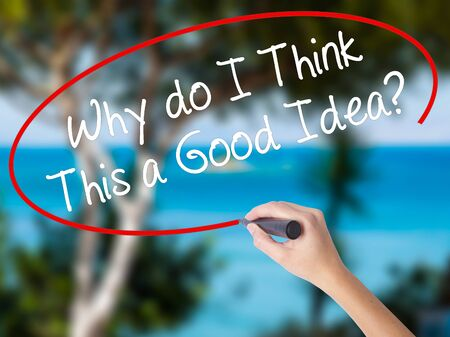 Woman Hand Writing Why do I Think This a Good Idea? with black marker on visual screen. Isolated on nature. Business concept. Stock Photo