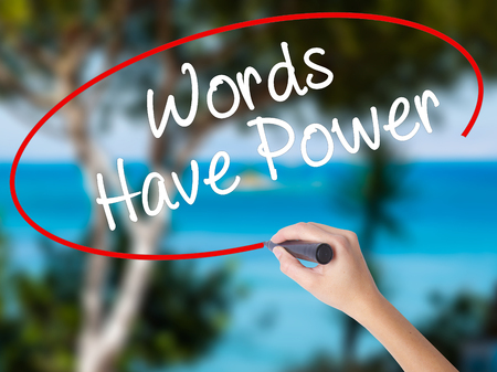 Woman Hand Writing Words Have Power with black marker on visual screen. Isolated on nature. Business concept. Stock Photo