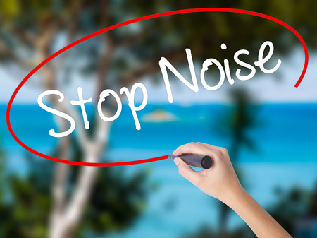 Woman Hand Writing Stop Noise   with black marker on visual screen. Isolated on nature. Business concept. Stock Photo Stock Photo
