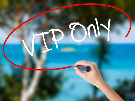 allowed to enter: Woman Hand Writing VIP Only   with black marker on visual screen. Isolated on nature. Business concept. Stock Photo