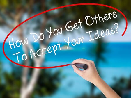 persuade: Woman Hand Writing How Do You Get Others To Accept Your Ideas? with black marker on visual screen. Isolated on nature. Business concept. Stock Photo Stock Photo