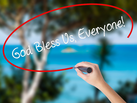 preachment: Woman Hand Writing God Bless Us, Everyone! with black marker on visual screen. Isolated on nature. Business concept. Stock Photo Stock Photo