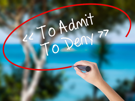 denying: Woman Hand Writing To Admit - To Deny with black marker on visual screen. Isolated on nature. Business concept. Stock Photo