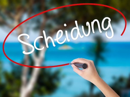 ex husband: Woman Hand Writing Scheidung (Divorce in German) with black marker on visual screen. Isolated on nature. Business concept. Stock Photo Stock Photo