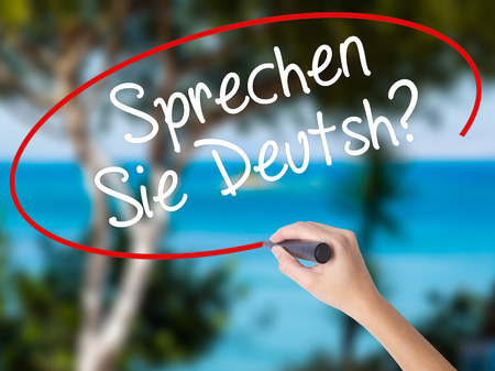 Woman Hand Writing Do You Speak German? (in German) with black marker on visual screen. Isolated on nature. Business concept. Stock Photo