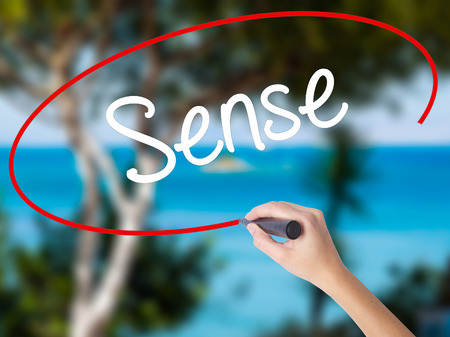 body consciousness: Woman Hand Writing  Sense with black marker on visual screen. Isolated on nature. Business concept. Stock Photo Stock Photo