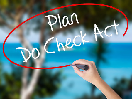 plan do check act: Woman Hand Writing Plan Do Check Act  with black marker on visual screen. Isolated on nature. Business concept. Stock Photo Stock Photo